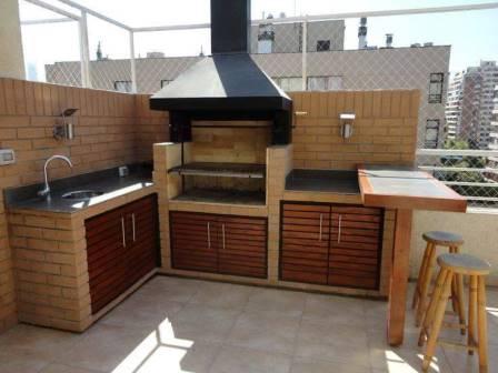 Espectaculares dise os de asadores para tu patio for Disenos de quinchos con piscinas
